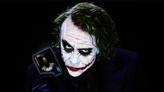 joker showing a card in batman movie