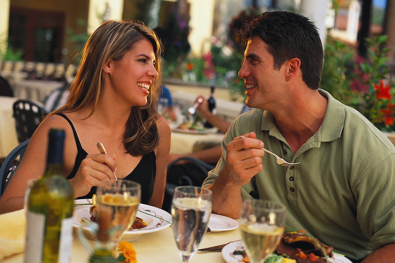 chivalry man and a women eating food together