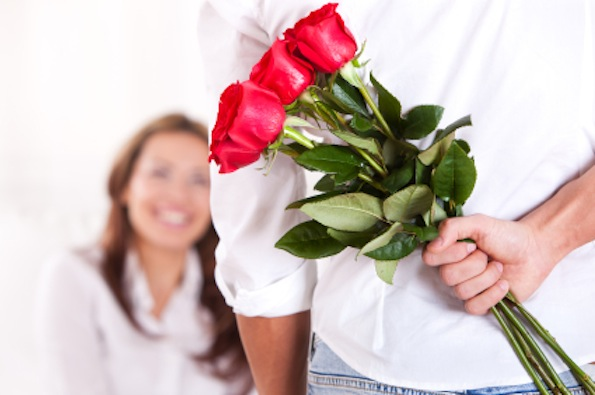 Chivalry man bringing flowers for his wife