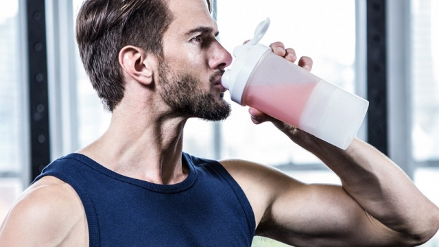 Man drinking BCAA and showing the benefits of BCAA's