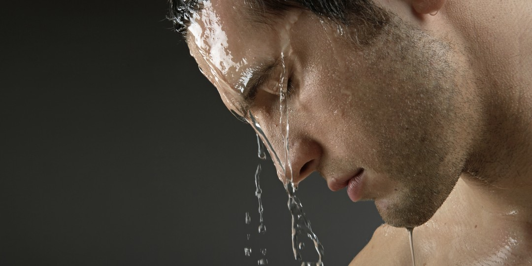 Man washing his face to get clear skin
