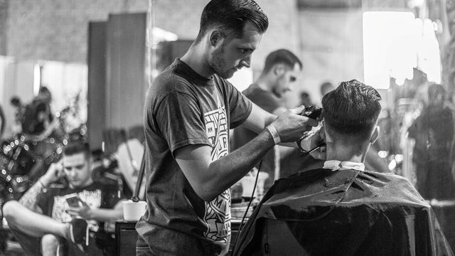 Barber showing different hairstyles for men