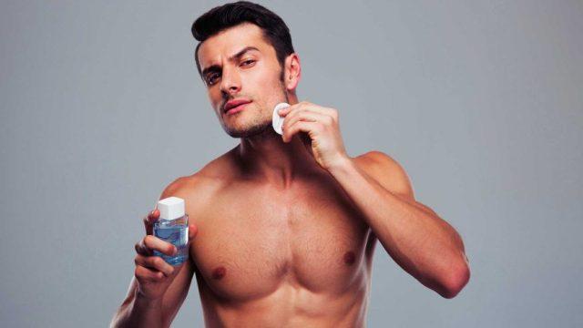 Man using scrub to get rid of blackheads