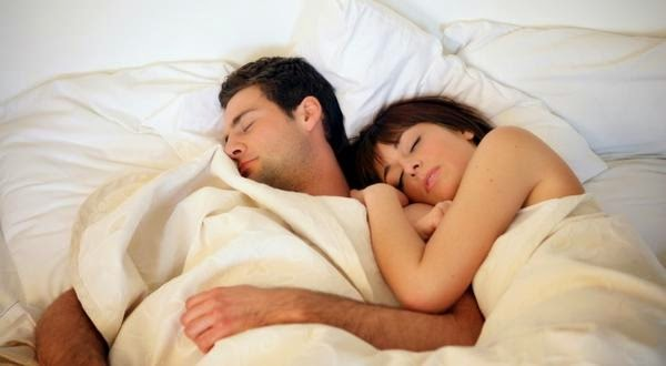 Couple sleeping naked