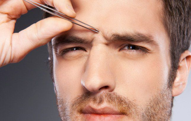 Man grooming eyebrows