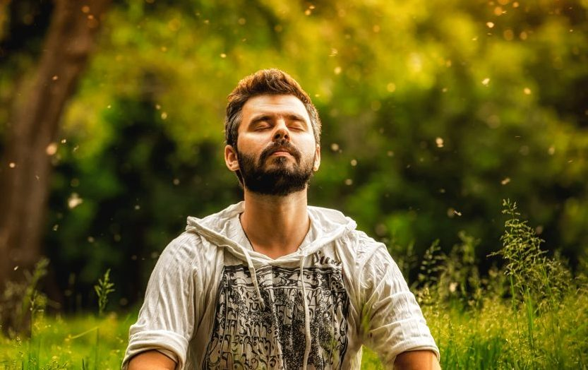 Man meditating with eyes closed