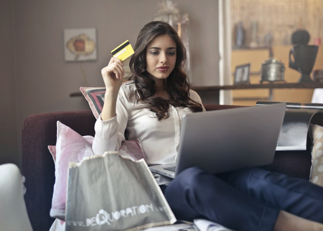 Women buying something using her credit card