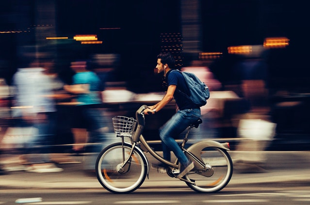 Man riding bicycle to be fit