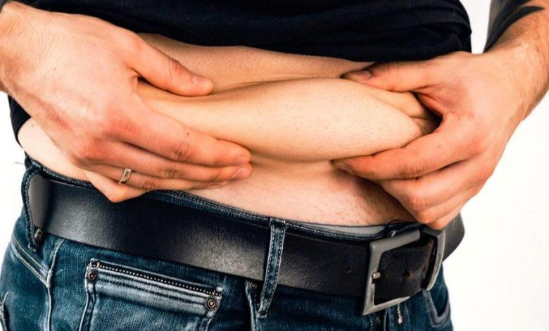 Man showing his stomach