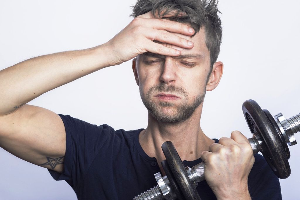 man in stress and dumbbell in hand