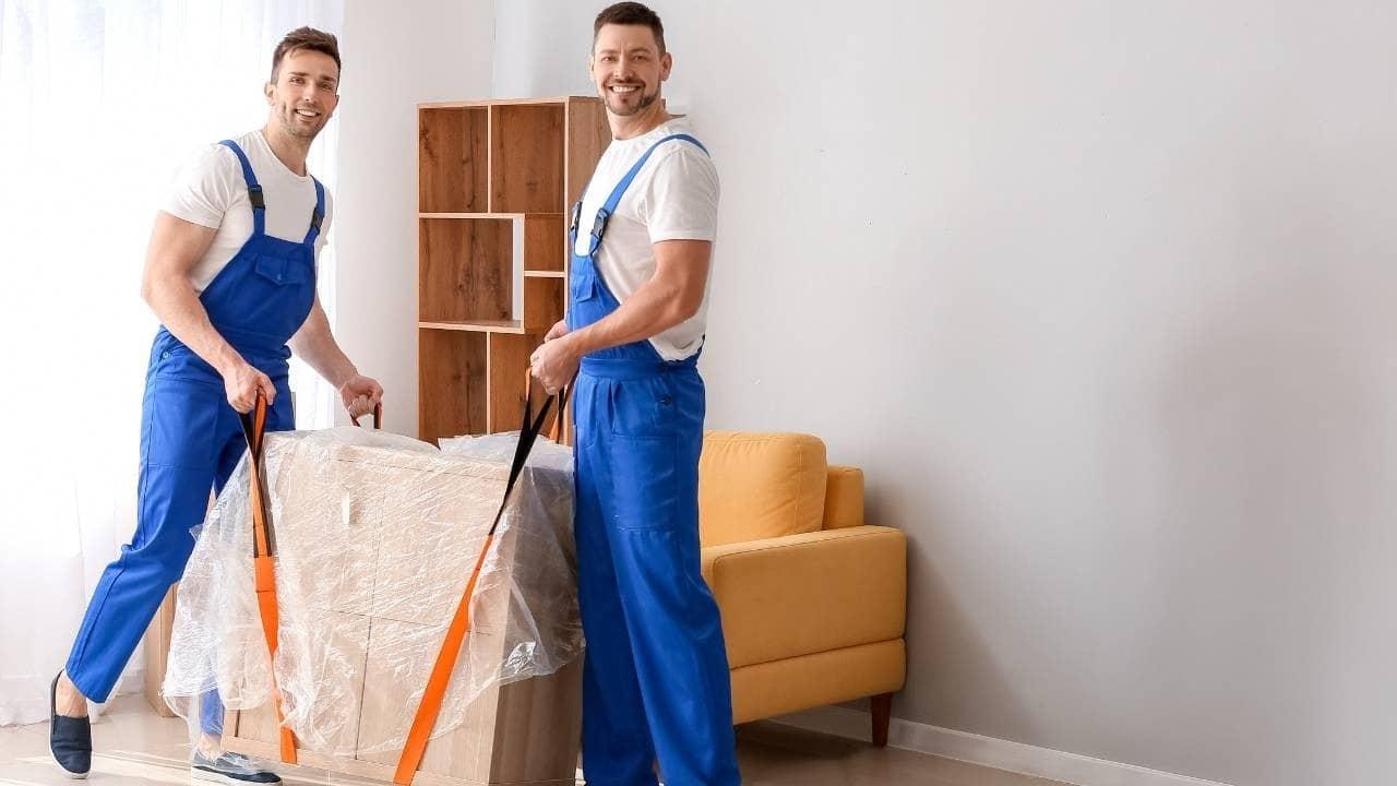 Guys taking apart furniture