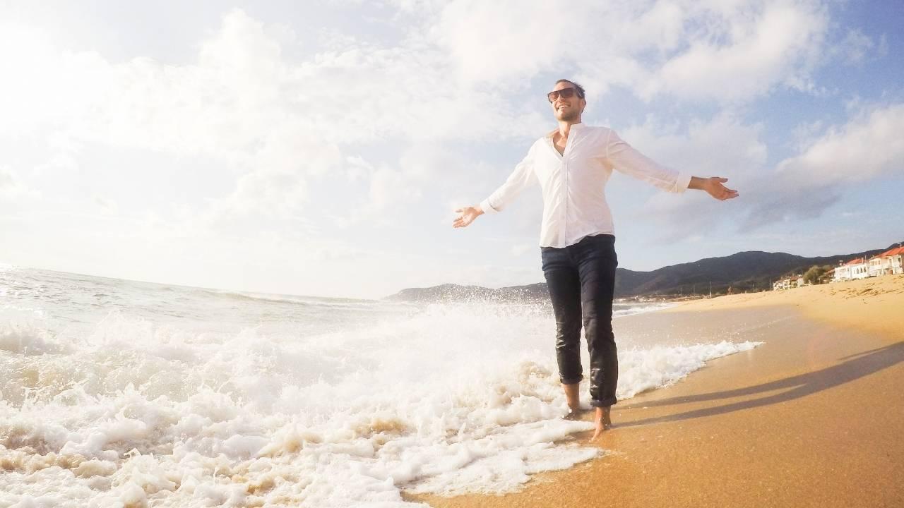 A man enjoying moment at the beach