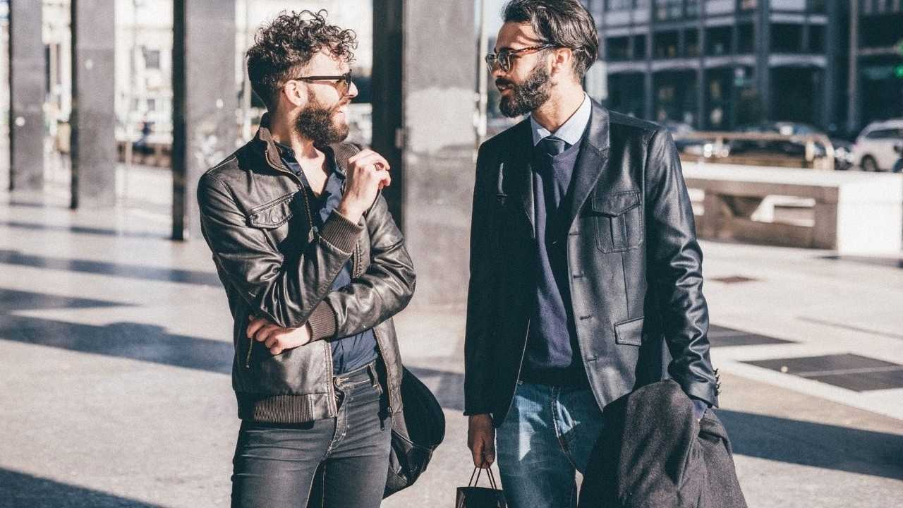 Fashionable guys talking to each other