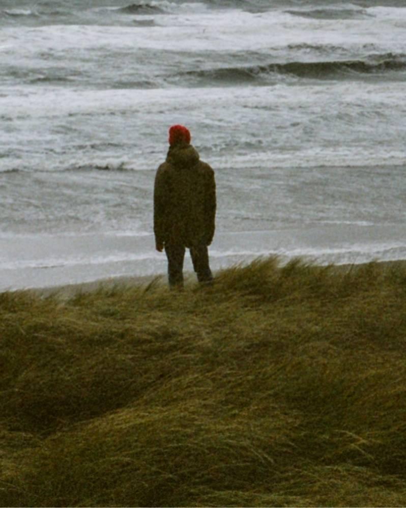 A good enough guy standing near a beach