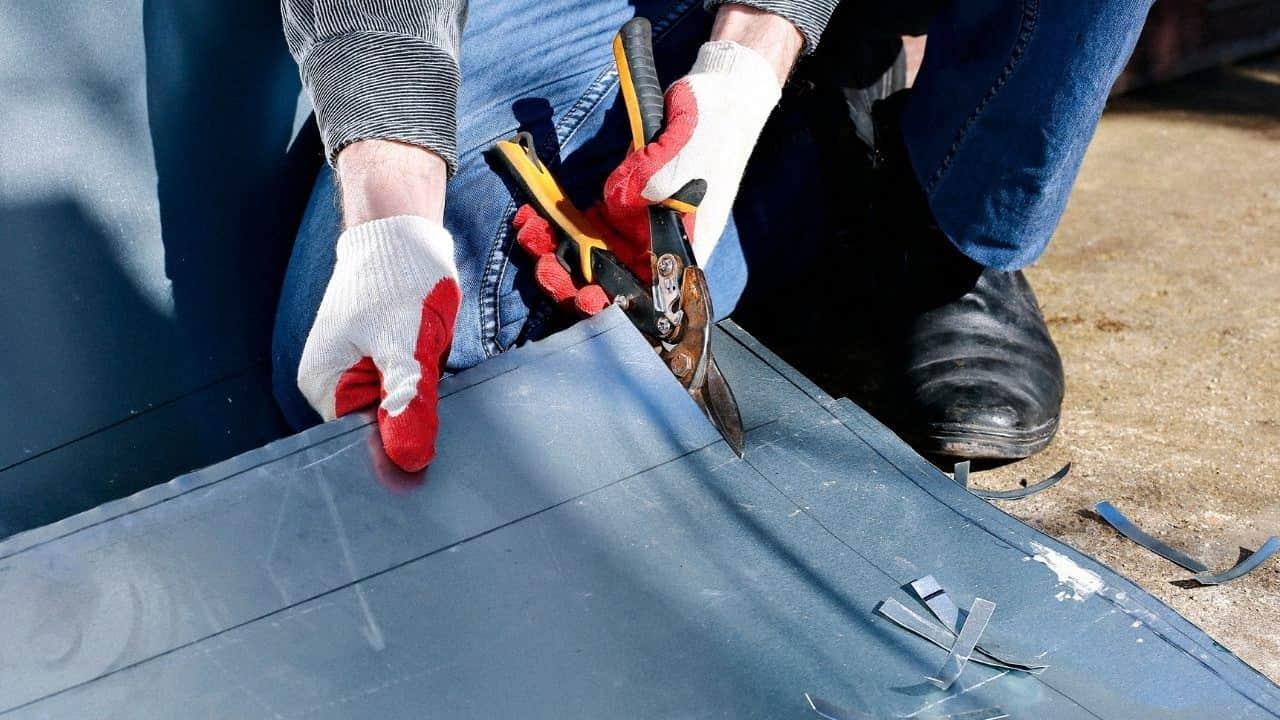 A man cutting sheet metal