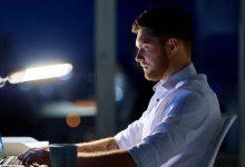 Entrepreneur working on laptop at night