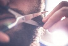 A guy taking care of his beard